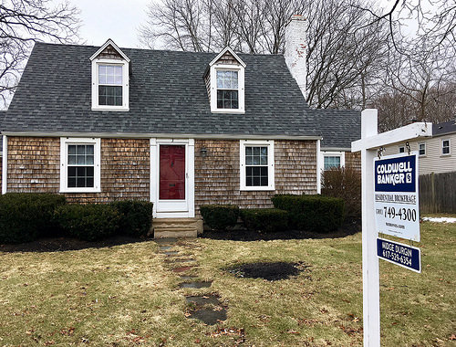 Cape house for sale with realtor for sale sign